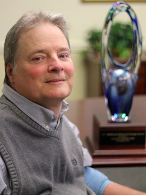 Photo of Dr. Krause with award