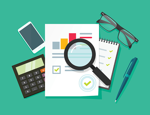 Image of a report, pen, calculator, glasses, phone, and magnifying glass